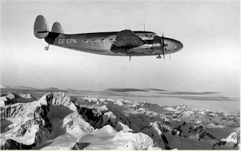 CF-CPA in wartime, pseudo camouflage livery, flying over some territory.